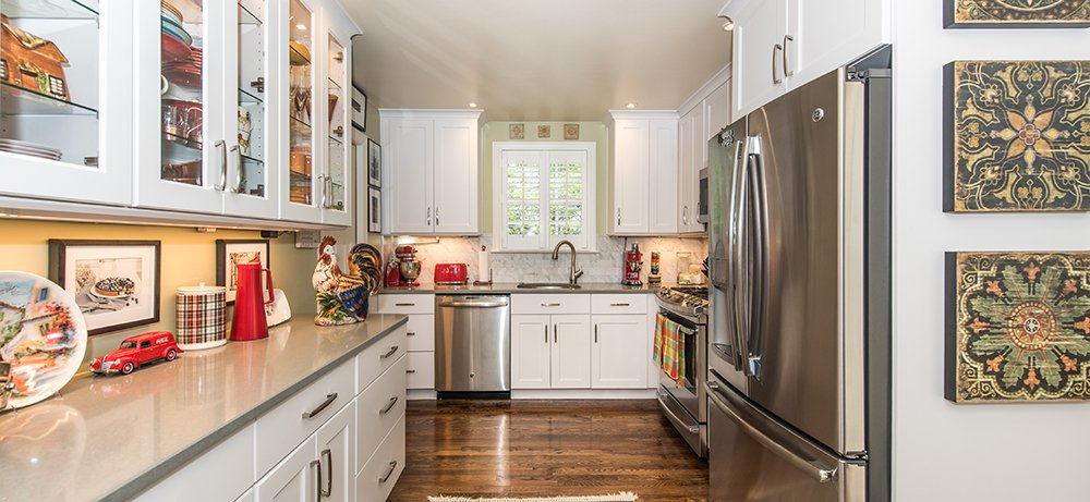 Classic White Kitchen in Arlington, VA with GE Appliances and Omega Cabinetry. ‹ ›