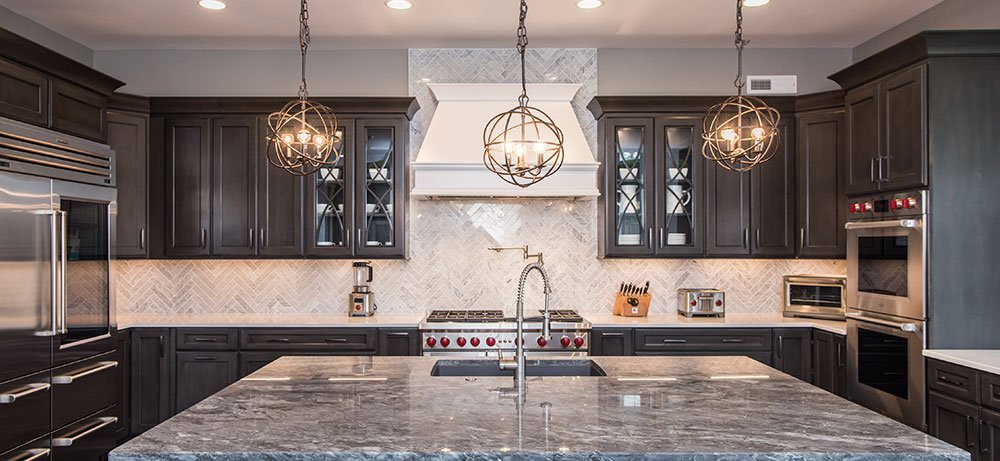 and wolf appliances and finally completed the look with an elegant herringbone design marble backsplash the new homebuyers adore their new kitchen and - Wolf Kitchen