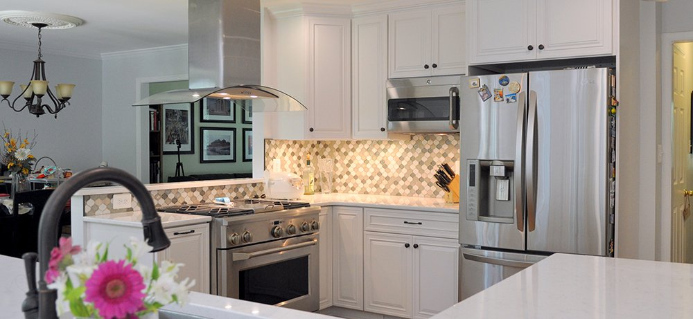 Spacious White Kitchen in Rockville, MD with GE Monogram ...